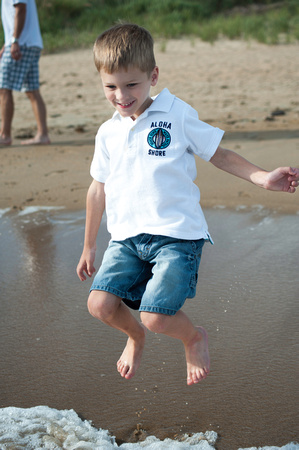 Little boy jumping the waves in Virginia Beach